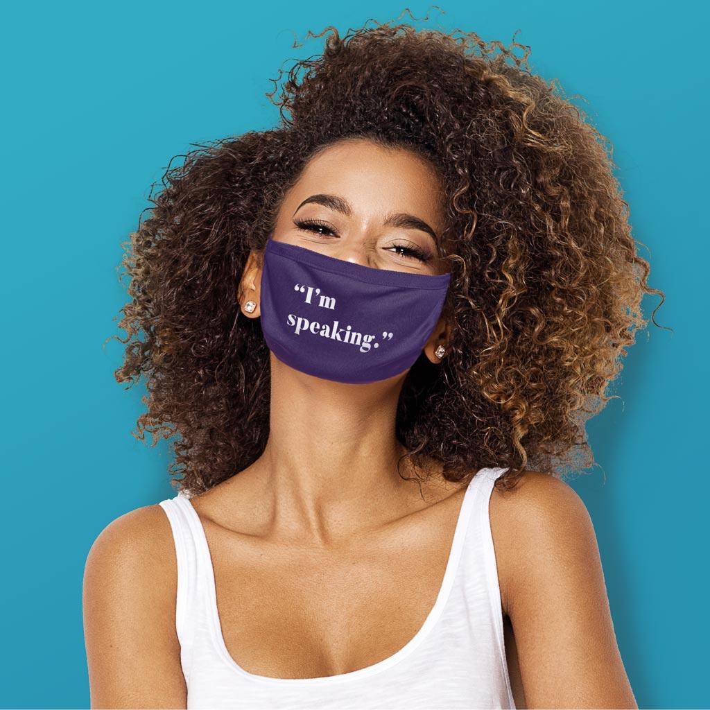 Photo of woman wearing purple 'I'm speaking' mask.