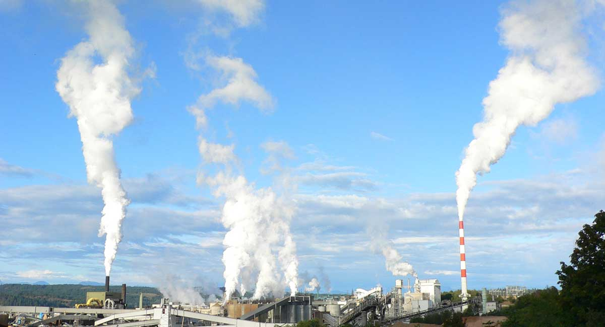 Chemical refinery with smokestacks