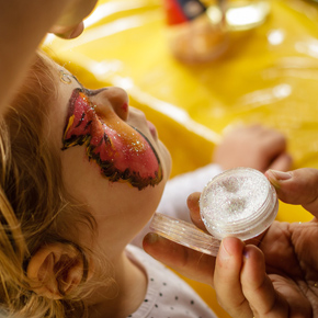 Face painting with glitter