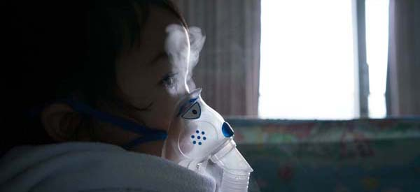 Child with nebulizer