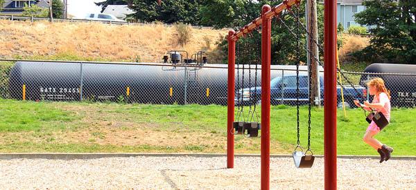 Oil train near playground