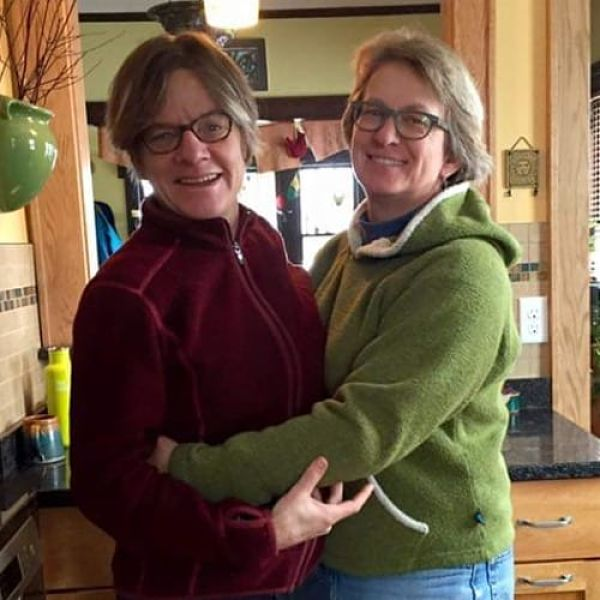 Carrie Framsted and her wife Monica Schliep in an embrace