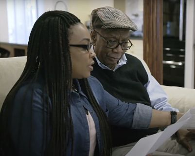 Father and daughter review a document together