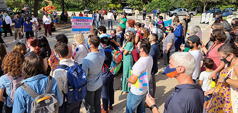 Equality Texans gathered to protest HB 25 before the hearing on Wednesday.