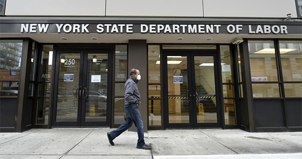 The New York State Department of Labor is one of many creaky systems that will be employed to deliver vital relief. (ANTHONY BEHAR/SIPA USA VIA AP IMAGES)