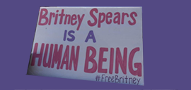"""a sign reading """"Britney Spears is a human being"""""""