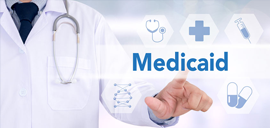a doctor pointing to the word medicaid
