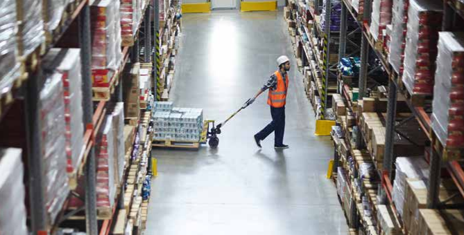 Photo shows a warehouse worker