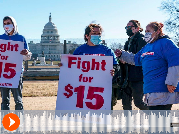 Image shows activists holding 'fight for $15' signs outside Capitol Hill