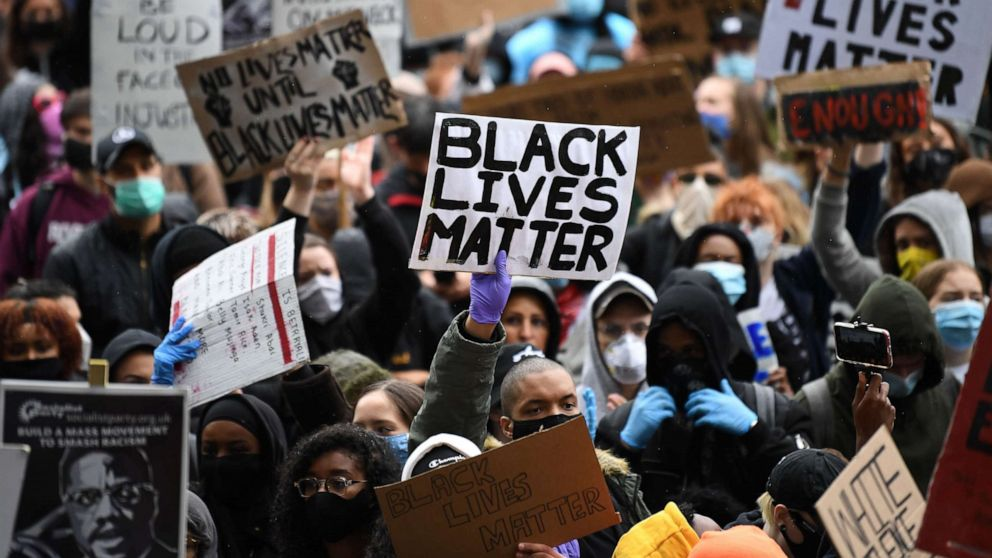 Protesters holding Black Lives Matter signs