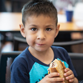 Child eating a sandwich