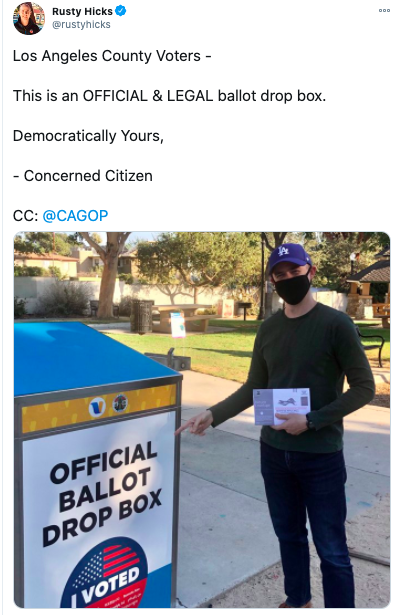 Tweet from Rusty Hicks including an image of him in front of a ballot drop box while holding his ballot.