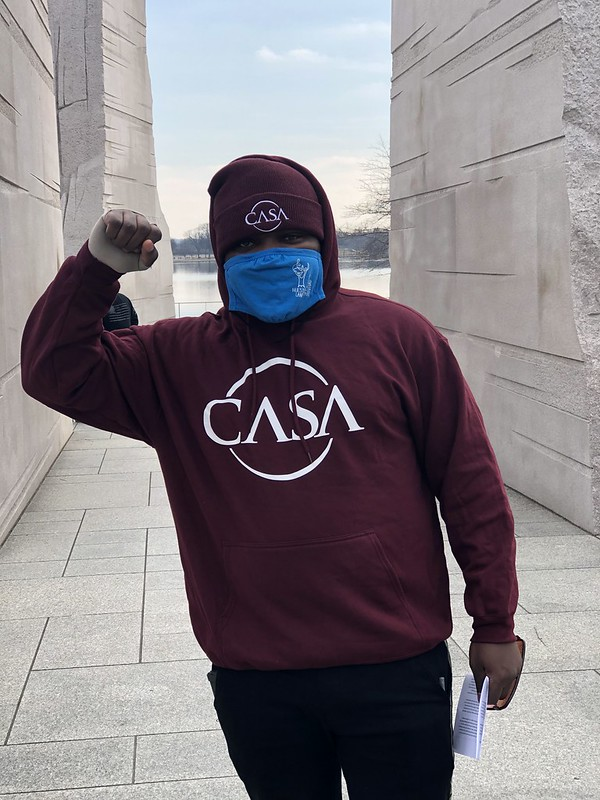 CASA member standing with fist raised