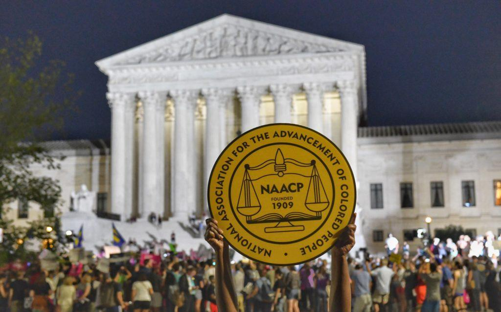 An NAACP sign in front of the Supreme Court.